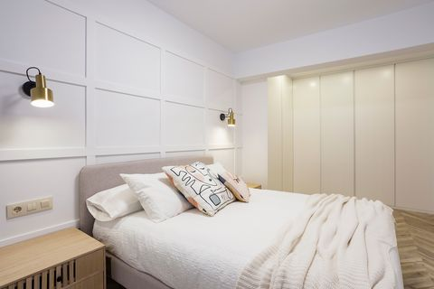 bedroom with headboard wall moldings in white