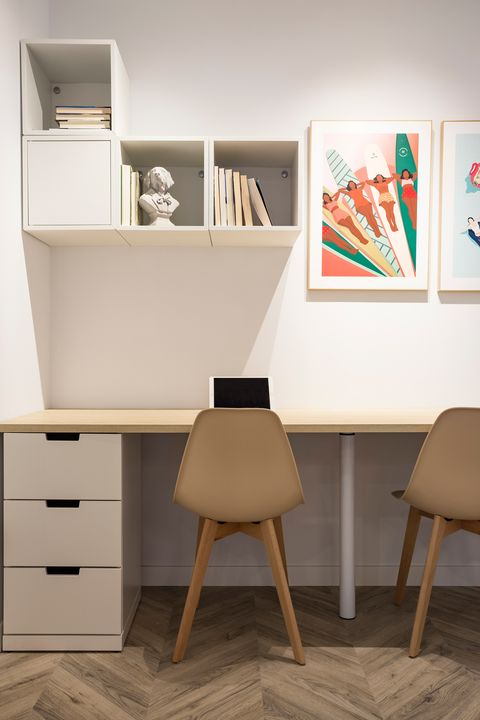 minimalist desk with two chairs, chest of drawers and wooden top