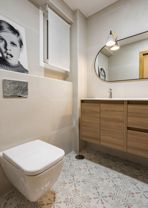 bathroom with suspended vanity unit and hydraulic tile floor