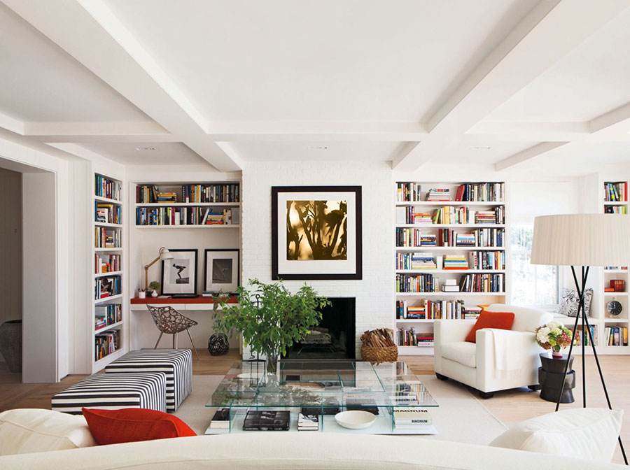 Ideas for decorating the living room with a wall bookcase n.23
