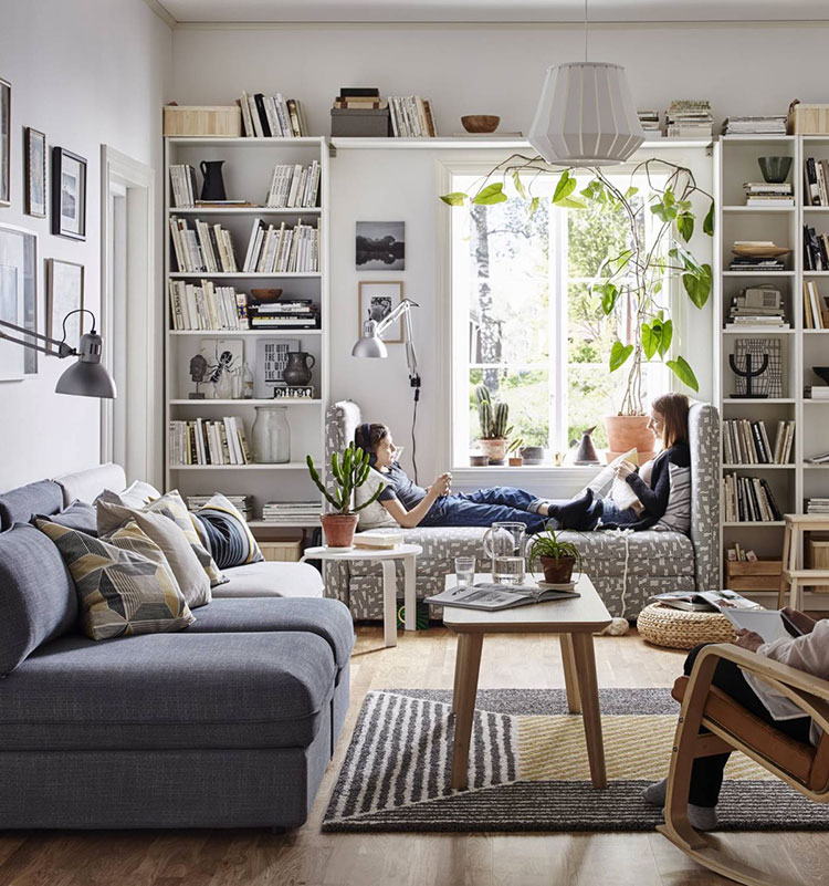Ideas for decorating the living room with a wall bookcase n.24
