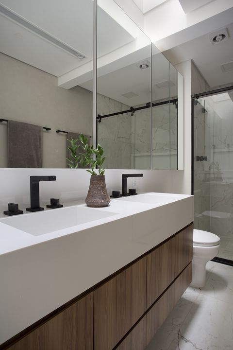 modern bathroom with double white stone sinks, shower and marble floor