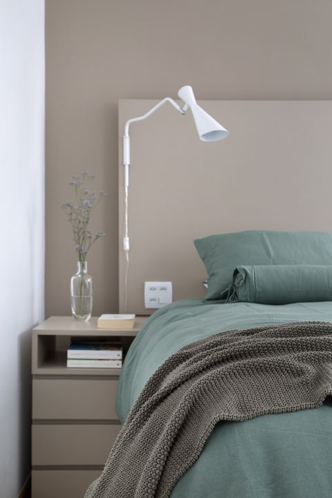 bedroom decorated in taupe with mint green duvet cover