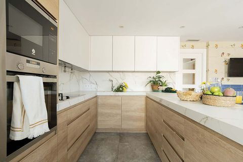 functional family floor kitchen in white and wood