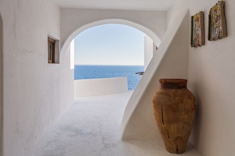 Mediterranean style hall in white stone with sea views