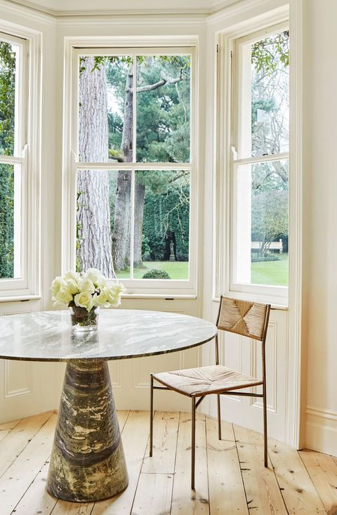 office with round marble table by the windows