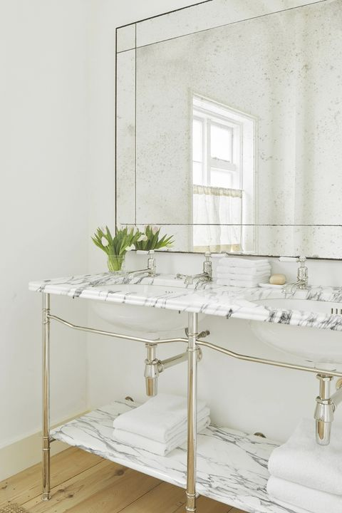 classic style bathroom with marble top and shelf