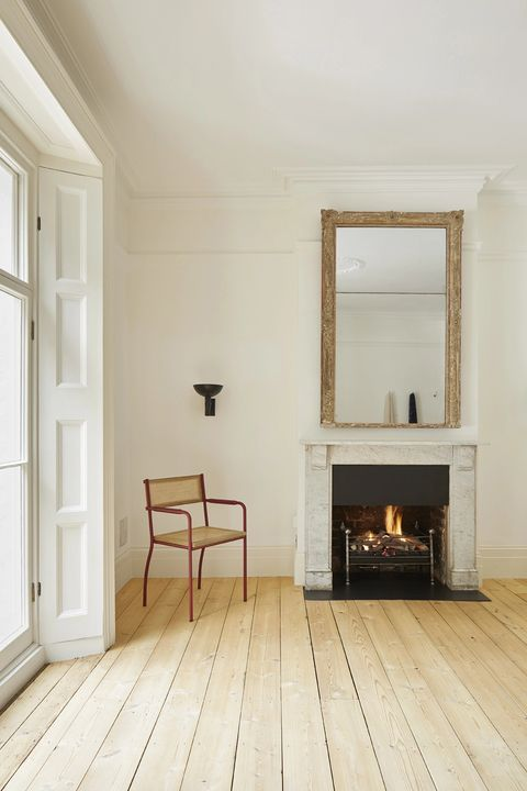 country-style living room with marble fireplace