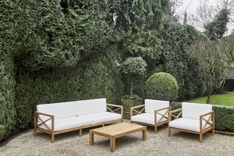 sofa, two armchairs and coffee table in the garden