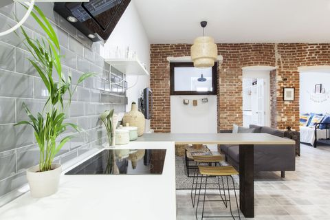 kitchen open to the living room with industrial style