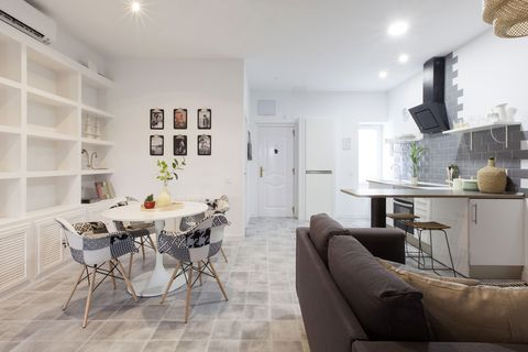 industrial style apartment living room, kitchen and dining room united
