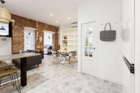 industrial style apartment with exposed brick wall
