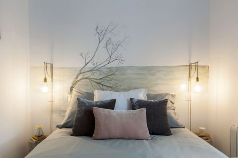 white decorated bedroom with custom headboard