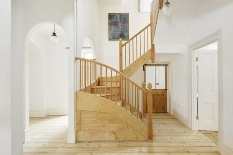 lobby with wooden stairs