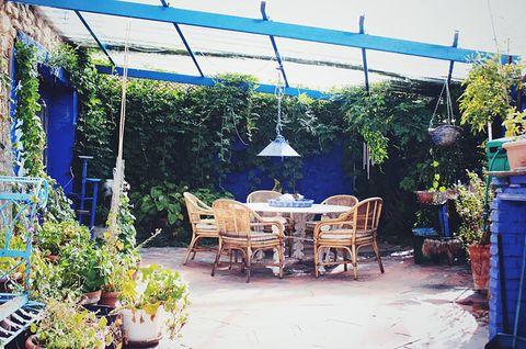 blue house by lucía bosé in brieva segovia patio with dining room