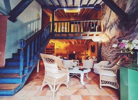 blue house by lucía bosé in brieva segovia staircase and wicker armchairs