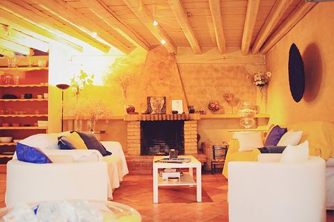 blue house by lucía bosé in brieva segovia living room with fireplace