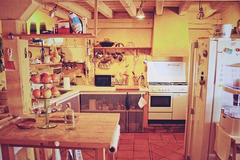 blue house by lucía bosé in brieva segovia kitchen with utensils with hangers