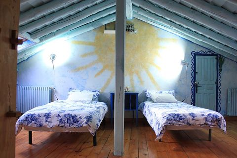 blue house by lucía bosé in brieva segovia double bedroom painted with sun