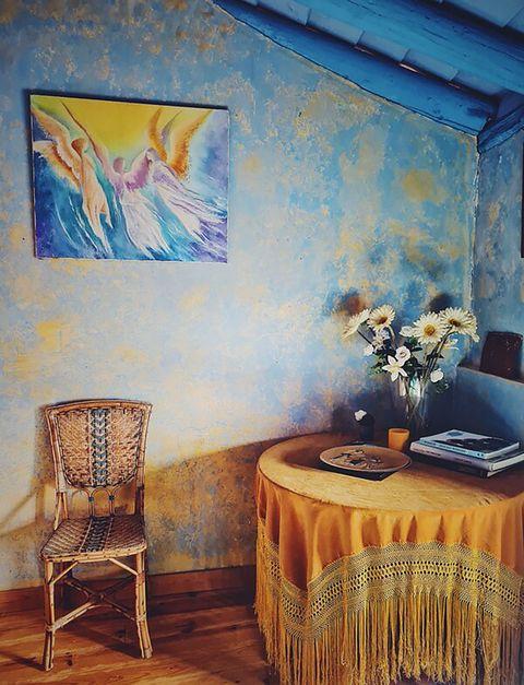blue house of lucía bosé in brieva segovia corner reading table stretcher