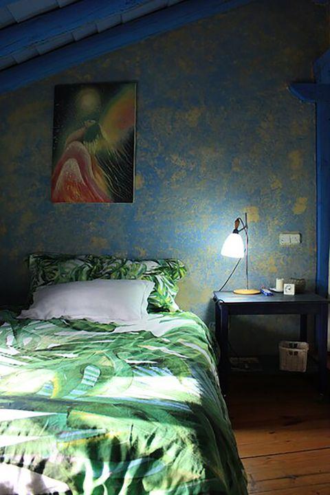 blue house by lucía bosé in brieva segovia attic bedroom