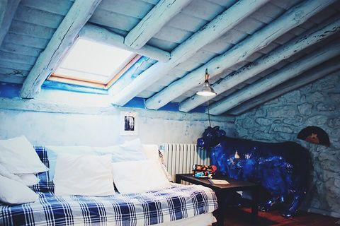 blue house by lucía bosé in brieva segovia attic with sofa bed