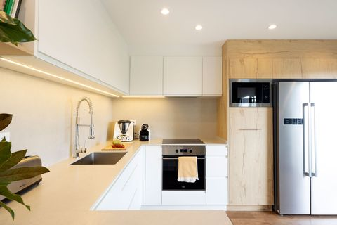 modern kitchen decorated in white and wood