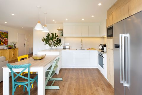 modern open kitchen decorated in white and wood with office