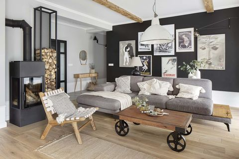 a nordic style country house living room in gray colors with an iron fireplace