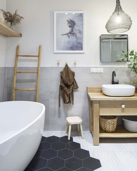 a nordic style country house bathroom with freestanding bathtub
