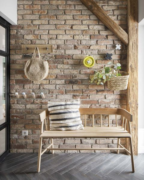 a nordic style country house hallway with brick wall