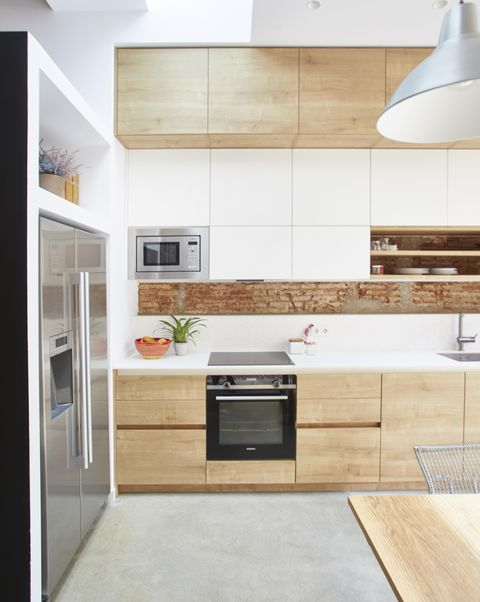 single-family house project by laiaubia studio wood paneled kitchen