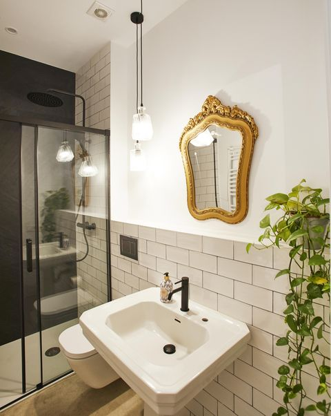single family house project by laiaubia studio bathroom with shower and mirror with gold frame