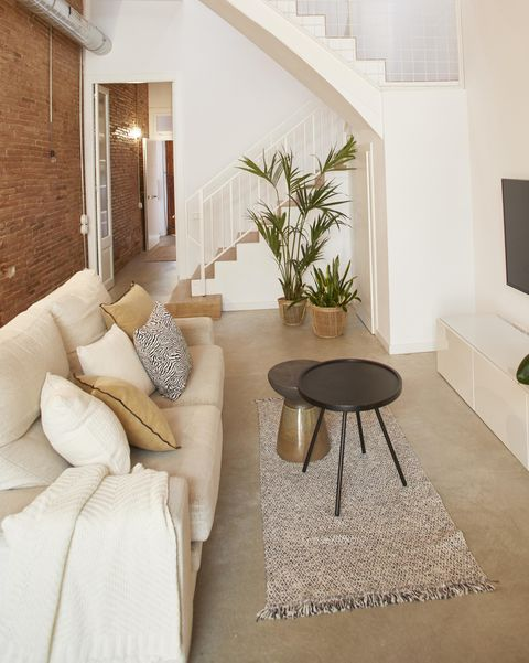 single family house project by laiaubia studio living room with exposed brick walls and white sofa